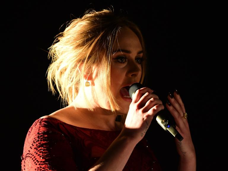 Adele performs onstage during the 58th Annual Grammy music Awards in Los Angeles February 15, 2016. AFP PHOTO/ ROBYN BECK