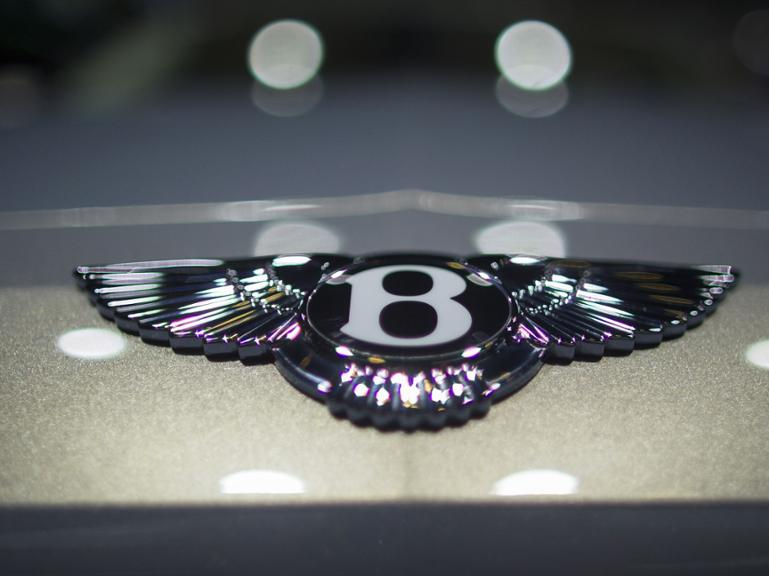(FILES) A photo taken on January 12, 2015, shows the Bentley badge on a Flying Spur W12 at the 2015 North American International Auto Show in Detroit, Michigan. Volkswagen&#39s luxury brand Bentley has recalled 27,640 cars worldwide because of potentially faulty battery cable connections, a Bentley spokesman said on October 27, 2015. The models affected were all Continental GT/GTC/Flying Spur and new Flying Spur cars built between February 2011 and June 2014, the spokesman said in an emailed statement. AFP PHOTO / GEOFF ROBINS