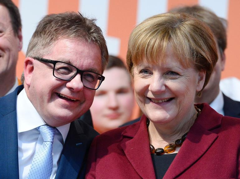 German Chancellor Angela Merkel (R) and Guido Wolf (L), top candidate of the Christian Democratic Union (CDU) for the state elections in German state Baden-Wuerttemberg, attend the last electoral meeting on March 12, 2016 in Haigerloch, southwestern Germany, ahead the regional state elections in Baden-Wuerttemberg.More than 12 million voters are electing three new regional parliaments for the southwestern states of Baden-Wuerttemberg and Rhineland-Palatinate, as well as eastern Saxony-Anhalt in the so-called Super Sunday polls. / AFP PHOTO / THOMAS KIENZLE